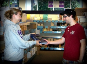 WSU Bookstore staff (like Amy Schmidtknecht, above) help you (and Josh Denzer, above) through the book-buying process.