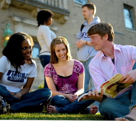 Three diversity club students relaxing outside.